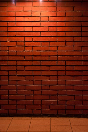Red Brick Wall Texture with a light from top downward Stock Photo - 10997524