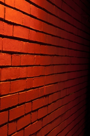 Red Brick Wall Texture with a light from top downward photo