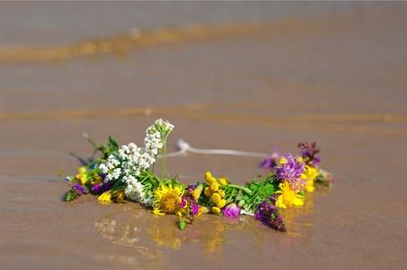 circlet: circlet of flowers on a sandy beach