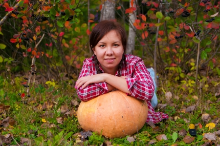 large pumpkin: Girl lying with a large pumpkin in the garden