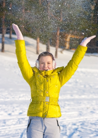 Girl throwing snow in the air photo