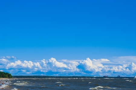clouds on blue sky above the sea Stock Photo