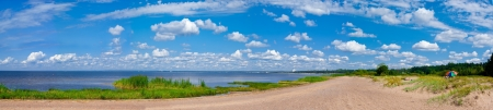 Panorama of gulf, meadow and blue sky