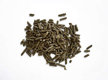Food green pellets for a domestic rodent on a white background. Hamster, rabbit, guinea pig, mouse, chinchilla, degu. Food pellets for a rodent isolated on a white background. Vegarian feed pile on a white background. Animal feed store, animal feed production, nutritious granules