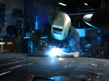 welding worker: Welder in blue light