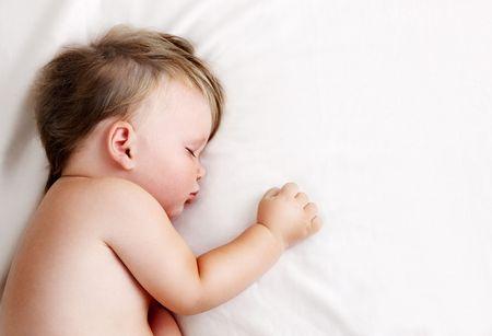 Baby sleeping and having sweet dreams Stock Photo