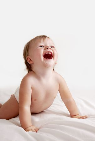 Baby in white sheets laughing Stock Photo - 7149436