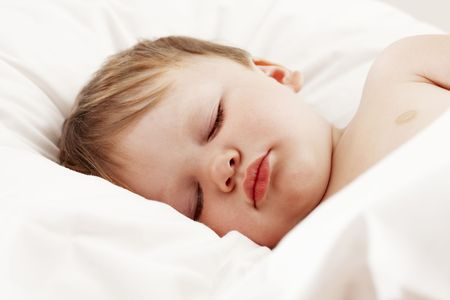 Baby sleeping in bed Stock Photo - 7149433