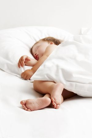 Baby sleeping in bed Stock Photo - 7149376