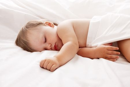 Baby sleeping in bed looking beautiful photo