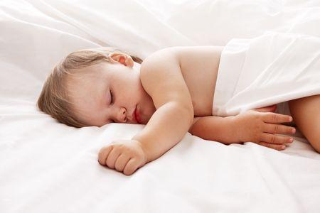 Baby sleeping in bed looking beautiful Stock Photo - 7149383
