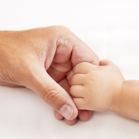baby hand holding dads hand Stock Photo