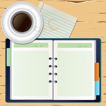 from above: a coffee and a notebook on the desk