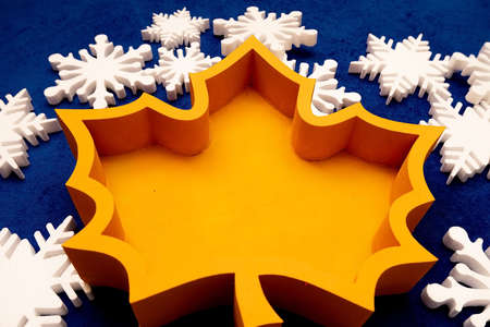 foam boxes made of pepoplast, extruded polystyrene foam for edible bouquets. orange leaf. gift wrapping on a background of snowflakes