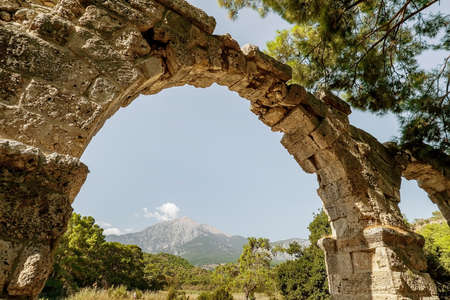 beautiful view of the ruins of the old town of Phaselis. sunny tourist day. view of the mountain tahtali