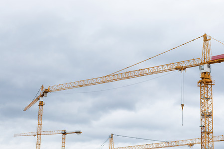Yellow building constraction cranes against the sky Stock Photo