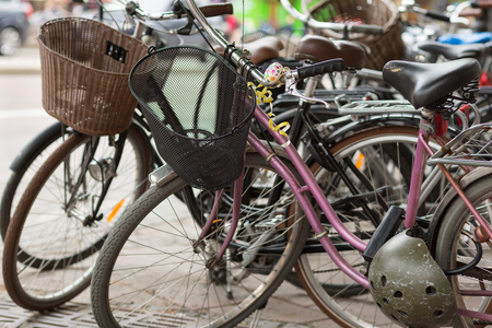 Retro bikes parked on the street in Stockholm, Sweden Stock Photo