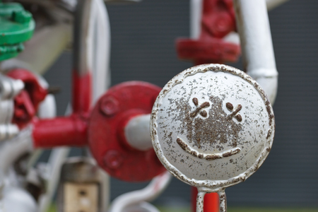 Smiley face on the pipes construction. Easy repairs concept.