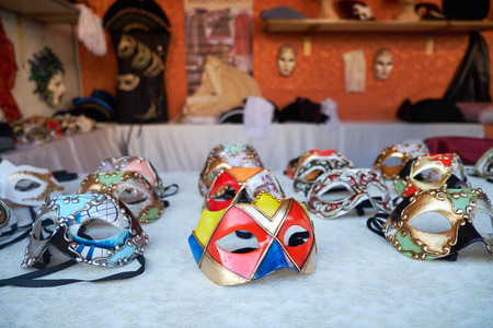 Traditional venetian masks for the Carnival in the street shop of Venice, Italy. Selective focus.