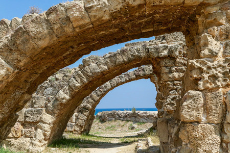 Famagusta, Turkish Republic of Northern Cyprus. Ruins of Ancient City Salamis. Stone archs. Sunny day, blue sky. 写真素材