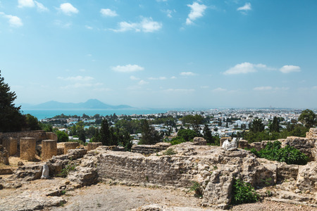 Archaeological Site. Ruins of punic district at Byrsa Hill in Carthage, Tunisia. Mediterranean Sea in the background.