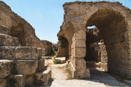 Archaeological Site. Ruins of Carthage at Baths of Antoninus, columns and fragments of the walls. Tunisia.
