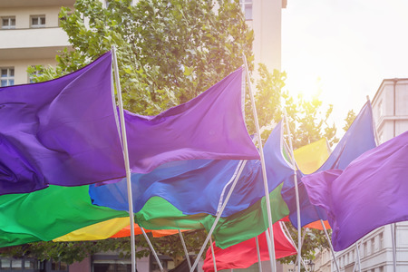 Flags in rainbow colors at the Prague Gay Pride parade. Toned picture, soft focus.