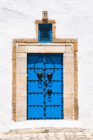 Traditional architecture with blue and white houses on the streets of Sidi Bou Said. Tunisia.