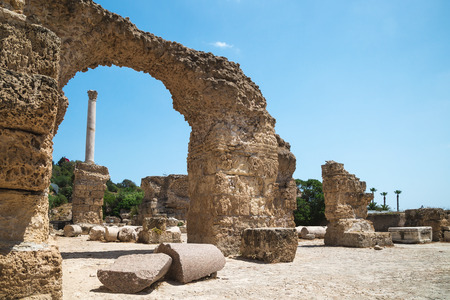 Archaeological Site. Ruins of Carthage at Baths of Antoninus, column and arch fragment of the wall. Tunisia. 写真素材