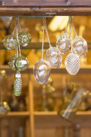 Christmas pine cones and balls decoration in a street bohemian crystal souvenir shop. Prague, Czech republic. Close up, selective focus.