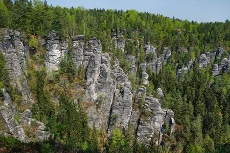 Rock formations Bastei in Saxon Switzerland National Park, Germany. Blue sky, springtime.