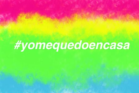 Spanish translation STAY HOME and hashtag I stay at home on watercolor colorful background. Spain extends emergency quarantine measures nationwide and advise people to stay home. Abstract illustration