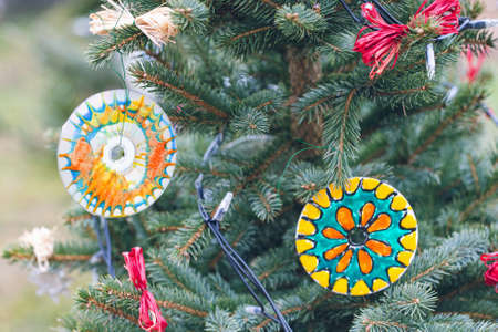 Handmade eco friendly Christmas decoration made of old CD or DVD discs. Diy ideas. Recycle, reuse, upcycling and zero waste concept. Selective focus, copy space