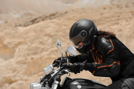A motorcyclist in a desert Stock Photo