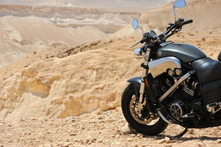 Motorcycle in a desert Stock Photo