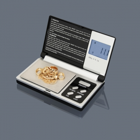 gram: Digital Scales and a golden scrap  Gram Scales  Stock Photo