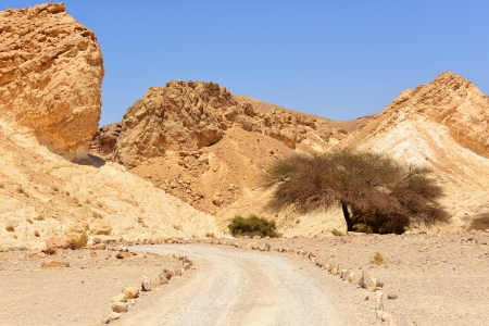 A road through mountains in the desert of Faran