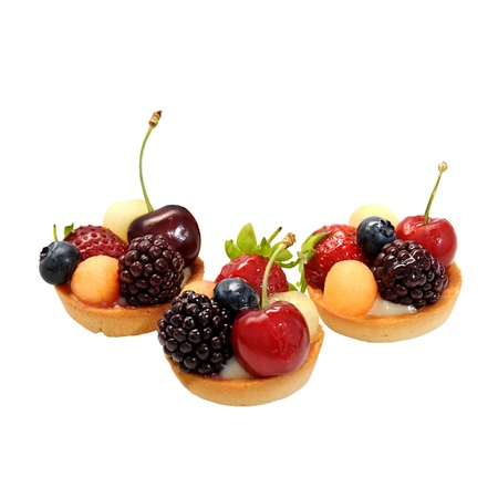 Italian small cakes with fruits and sweet syrup