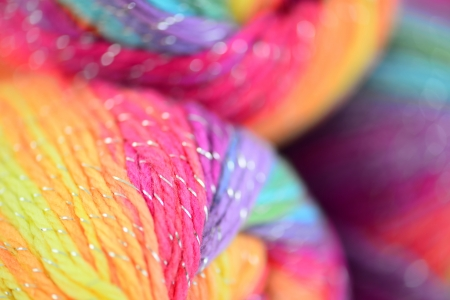 Yarn close up with blur effect. Bright abstract composition of yarns