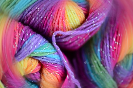 lurex: Yarn with a blur effect. Bright colors and soft blur. Stock Photo