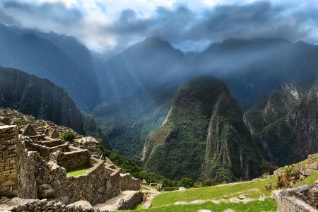 the lost city of the incas: The Lost City of the Incas  Sunbeams on dark mountains  Stock Photo