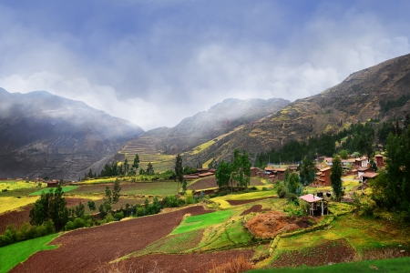 Peruvian village in mountains. Peruvian agriculture on high mountains. photo