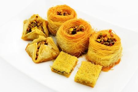 baklawa: Assortment of Arabic baklava with pistachios. Traditional Arabic dessert.