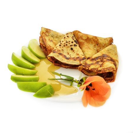 Sweet pancakes with honey and apple. Decorated flower.