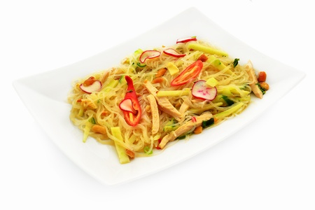 Vietnamese salad with noodles, chicken, nuts, hot pepper, apple and radish, Stock Photo