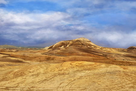 judean desert: Landscape in the Judean desert. A beautiful combination of blue sky and bright yellow hills. Stock Photo