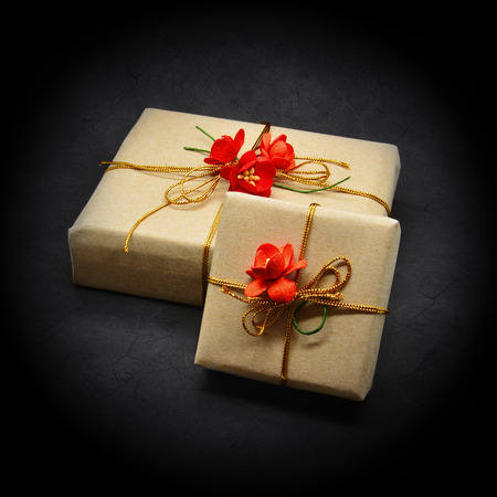 Gift boxes wrapped brown paper and decorated red flowers black gift boxes wrapped brown paper and decorated red flowers black stock photo picture and royalty free image image 32342445 mightylinksfo