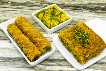 baklawa: Baklava with pistachios and honey. Rolls and cakes. Stock Photo