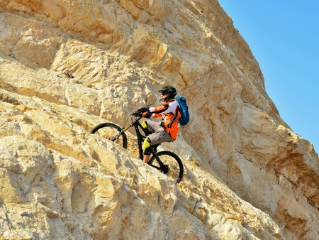 mountain biker: Mountain biker in mountains