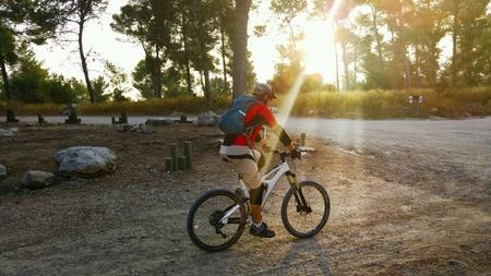mountain biker: Mountain biker in sunbeams